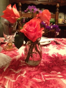 Coral roses to match the voile tablecloth